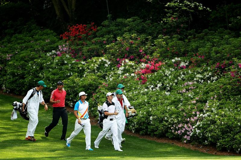 AUGUSTA, GA - APRIL 08:  Jason Day of Australia, Rickie Fowler and Rory McIlroy of Northern Ireland walk down the sixth fairway with their caddies during the second round of the 2011 Masters Tournament at Augusta National Golf Club on April 8, 2011 in Augusta, Georgia.  (Photo by Jamie Squire/Getty Images)
