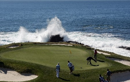 PEBBLE BEACH, CA - FEBRUARY 10:  Dustin Johnson (L) and Vijay Singh of Fiji prepare to putt on the seventh hole during the final round of the AT&T Pebble Beach National Pro-Am at the Pebble Beach Golf Links February 10, 2008 in Pebble Beach, California.  (Photo by Jeff Gross/Getty Images)