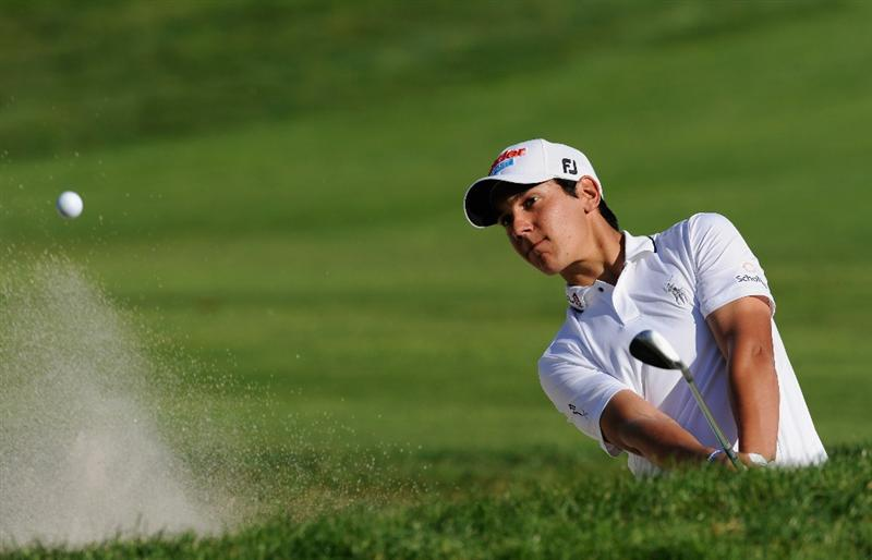CASTELLON DE LA PLANA, SPAIN - OCTOBER 24:  Matteo Manassero of Italy plays his bunker shot on the 13th hole during the final round of the Castello Masters Costa Azahar at the Club de Campo del Mediterraneo on October 24, 2010 in Castellon de la Plana, Spain.  (Photo by Stuart Franklin/Getty Images)
