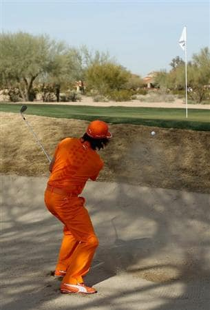 SCOTTSDALE, AZ - FEBRUARY 06:  Rickie Fowler chips out of the bunker onto the second hole green during the final round of the Waste Management Phoenix Open at TPC Scottsdale on February 6, 2011 in Scottsdale, Arizona.  (Photo by Christian Petersen/Getty Images)