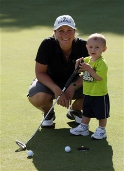 SUNNINGDALE, UNITED KINGDOM - JULY 30:  Karen Stupples of England poses with her young son Logan on the practice putting green during the final day of practice for the 2008  Ricoh Women's British Open Championship held on the Old Course at Sunningdale Golf Club, on July 30, 2008 in Sunningdale, England.  (Photo by David Cannon/Getty Images)