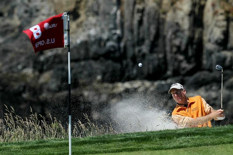 PEBBLE BEACH, CA - JUNE 16:  Jim Furyk hits a bunker shot during a practice round prior to the start of the 110th U.S. Open at Pebble Beach Golf Links on June 16, 2010 in Pebble Beach, California.  (Photo by Stephen Dunn/Getty Images)