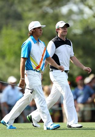 AUGUSTA, GA - APRIL 08:  (L-R) Rickie Fowler and Rory McIlroy of Northern Ireland walk up the 14th hole together during the second round of the 2011 Masters Tournament at Augusta National Golf Club on April 8, 2011 in Augusta, Georgia.  (Photo by Andrew Redington/Getty Images)