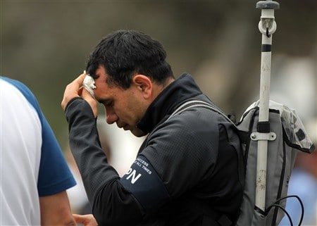 SAN DIEGO - JUNE 13:  A member of the ESPN TV crew after being hit by the golf ball of Phil Mickelson on the first hole during the second round of the 108th U.S. Open at the Torrey Pines Golf Course (South Course) on June 13, 2008 in San Diego, California.  (Photo by Doug Pensinger/Getty Images)