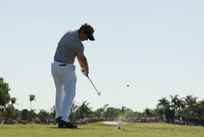 DORAL, FL - MARCH 13:  Luke Donald of England hits his tee shot on the fourth hole during the final round of the 2011 WGC- Cadillac Championship at the TPC Blue Monster at the Doral Golf Resort and Spa on March 13, 2011 in Doral, Florida.  (Photo by Mike Ehrmann/Getty Images)