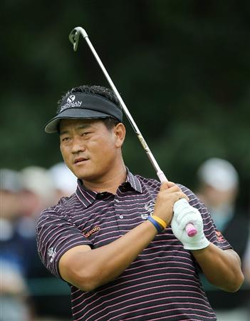LEMONT, IL - SEPTEMBER 09:  K.J. Choi of South Korea watches his tee shot on the second hole during the first round of the BMW Championship at Cog Hill Golf & Country Club on September 9, 2010 in Lemont, Illinois.  (Photo by Jamie Squire/Getty Images)