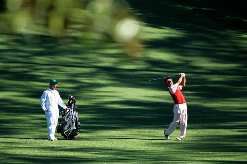 AUGUSTA, GA - APRIL 06:  Yuta Ikeda of Japan hits a shot during a practice round prior to the 2011 Masters Tournament at Augusta National Golf Club on April 6, 2011 in Augusta, Georgia.  (Photo by David Cannon/Getty Images)