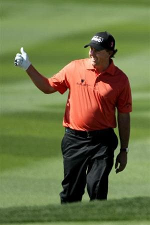 MARANA, AZ - FEBRUARY 24:  Phil Mickelson waves as he walks up the fairway on the 13th hole during the second round of the Accenture Match Play Championship at the Ritz-Carlton Golf Club on February 24, 2011 in Marana, Arizona.  (Photo by Andy Lyons/Getty Images)