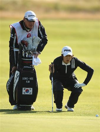LYTHAM ST ANNES, ENGLAND - JULY 30:  Song-Hee Kim of Korea lines up a shot to the 16th green with her caddie during the first round of the 2009 Ricoh Women's British Open Championship held at Royal Lytham St Annes Golf Club, on July 30, 2009 in  Lytham St Annes, England.  (Photo by Warren Little/Getty Images)