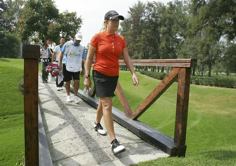 GUADALAJARA, MEXICO - NOVEMBER 12:  Cristie Kerr of the United States crosses a bridge during the second round of the Lorena Ochoa Invitational Presented by Banamex and Corona Light at Guadalajara Country Club on November 12, 2010 in Guadalajara, Mexico.  (Photo by Michael Cohen/Getty Images)
