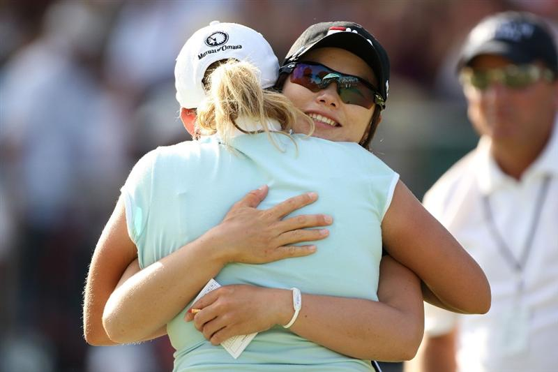 BETHLEHEM, PA - JULY 12:  Cristie Kerr hugs Eun Hee Ji of South Korea after finishing the final round of the 2009 U.S. Women's Open at Saucon Valley Country Club on July 12, 2009 in Bethlehem, Pennsylvania.  (Photo by Streeter Lecka/Getty Images)