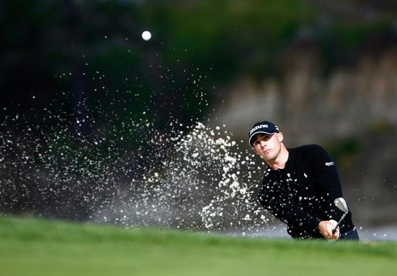 PEBBLE BEACH, CA - FEBRUARY 13:  Jonathan Byrd hits a bunker shot to the sixth green during the second round of the AT&T Pebble Beach National Pro-Am at the Pebble Beach Golf Links on February 13, 2009 in Pebble Beach, California.  (Photo by Jeff Gross/Getty Images)