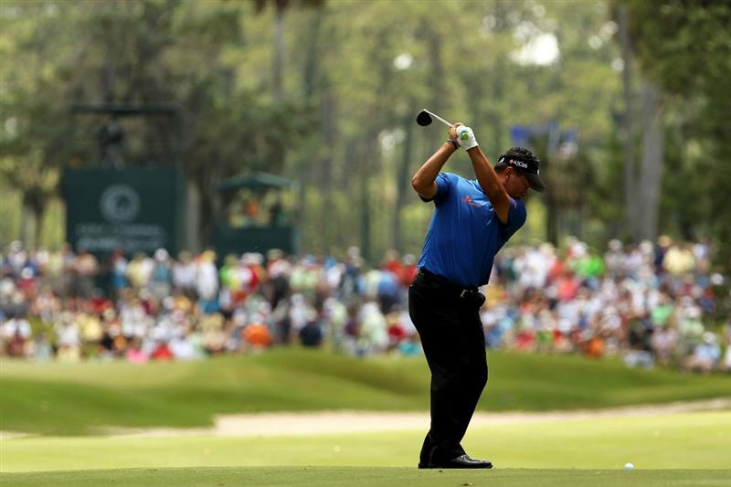 PONTE VEDRA BEACH, FL - MAY 15:  K.J. Choi of South Korea hits an approach shot on the second hole during the final round of THE PLAYERS Championship held at THE PLAYERS Stadium course at TPC Sawgrass on May 15, 2011 in Ponte Vedra Beach, Florida.  (Photo by Mike Ehrmann/Getty Images)