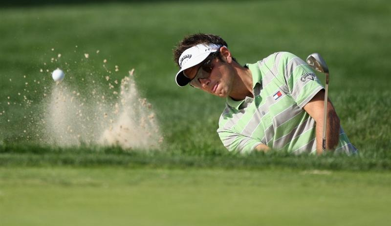 SEVILLE, SPAIN - MARCH 26:  Nick Dougherty of England plays out of the 12th greenside bunker during the first round of the Open de Andalucia at Real Club de Golf de Seville Club on March 26, 2009 in Seville, Spain.  (Photo by Warren Little/Getty Images)