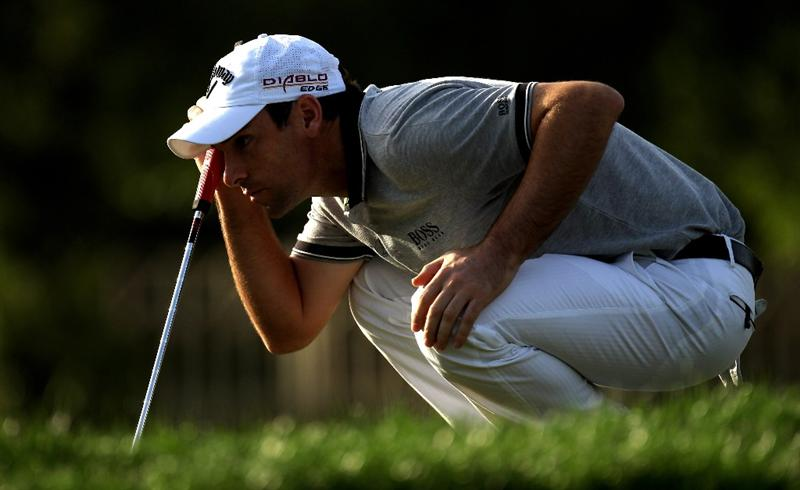 DUBAI, UNITED ARAB EMIRATES - FEBRUARY 04:  Oliver Wilson of England on the par three 11th hole during the first round the Omega Dubai Desert Classic on the Majlis Course at the Emirates Golf Club on February 4, 2010 in Dubai, United Arab Emirates.  (Photo by Ross Kinnaird/Getty Images)
