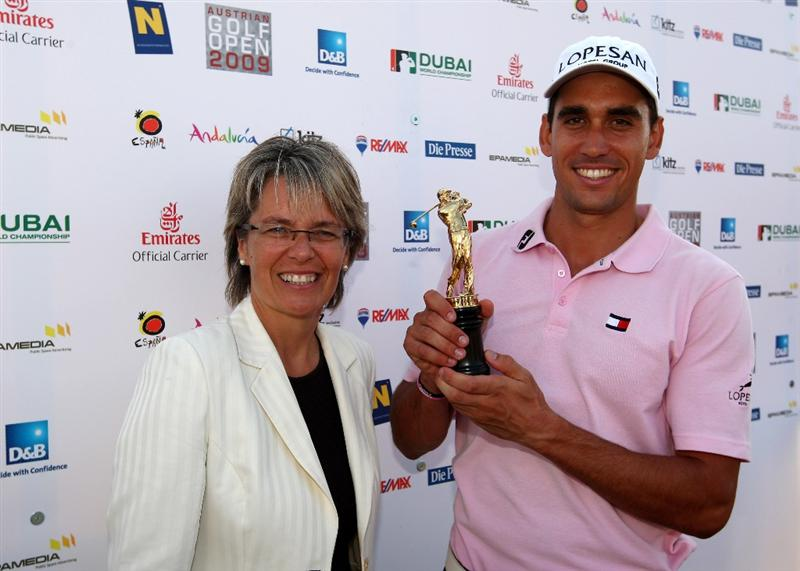 VIENNA, AUSTRIA - SEPTEMBER 20:  Rafael Cabrera-Bello of Spain (R) is presented with the trophy by Petra Bohuslav, Minister for Sport in Lower Austria, after the fourth round of the Austrian Golf Open at Fontana Golf Club on September 20, 2009 in Vienna, Austria.  (Photo by Richard Heathcote/Getty Images)