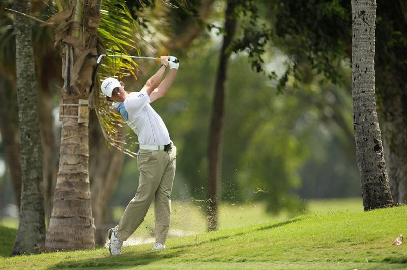DORAL, FL - MARCH 12:  Rory McIlroy of Northern Ireland hits a shot from the rough on the first hole during the third round of the 2011 WGC- Cadillac Championship at the TPC Blue Monster at the Doral Golf Resort and Spa on March 12, 2011 in Doral, Florida.  (Photo by Mike Ehrmann/Getty Images)