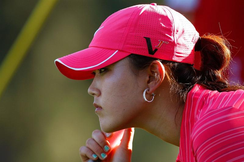 GUADALAJARA, MEXICO - NOVEMBER 15:  Michelle Wie of the United States lines up her par putt on the 17th green during the final round of the Lorena Ochoa Invitational Presented by Banamex and Corona at Guadalajara Country Club on November 15, 2009 in Guadalajara, Mexico.  (Photo by Kevin C. Cox/Getty Images)
