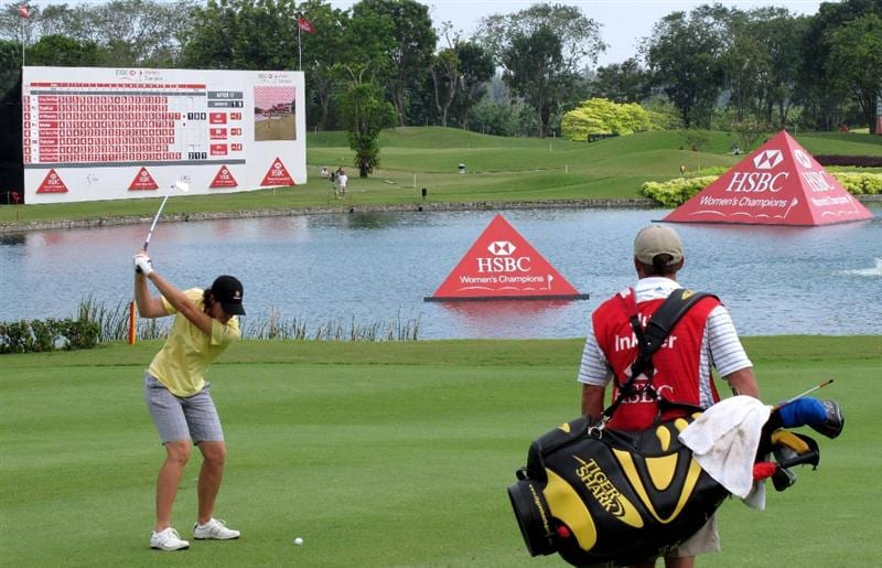 SINGAPORE - FEBRUARY 27:  Juli Inkster of the USA plays her second shot on the 18th hole during the third round of the HSBC Women's Champions at the Tanah Merah Country Club on February 27, 2010 in Singapore.  (Photo by Andrew Redington/Getty Images)