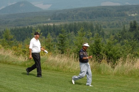 John Jacobs and Vincente Fernandez walk down the 12th fairway during the first round of the 2005 Boeing Greater Seattle Classic at TPC Snoqualmie in Snoqualmie, Washington August 19, 2005.Photo by Steve Grayson/WireImage.com
