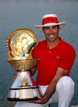DOHA, QATAR - JANUARY 25:  Alvaro Quiros of Spain poses with the trophy after winning the Commercialbank Qatar Masters at Doha Golf Club on January 25, 2009 in Doha, Qatar.  (Photo by Andrew Redington/Getty Images)