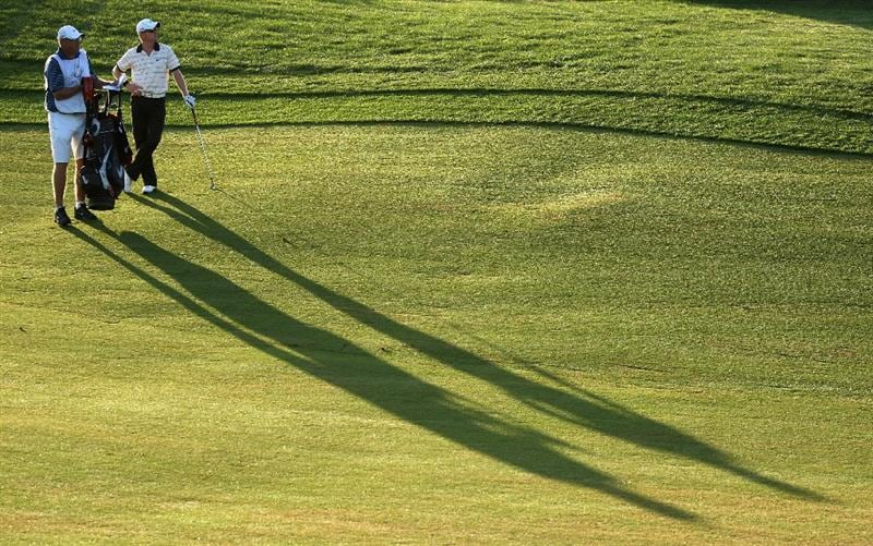 VILAMOURA, PORTUGAL - OCTOBER 16:  Simon Dyson of England waits with his caddie Guy Tilson on the tenth hole during the second round of the Portugal Masters at the Oceanico Victoria Golf Course on October 16, 2009 in Vilamoura, Portugal.  (Photo by Andrew Redington/Getty Images)