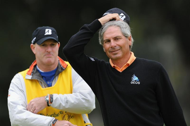 PACIFIC PALISADES, CA - FEBRUARY 18:  Fred Couples and caddie ponders his putt on the 11th hole during the second round of the Northern Trust Open at Riviera Country Club on February 18, 2011 in Pacific Palisades, California.  (Photo by Stuart Franklin/Getty Images)