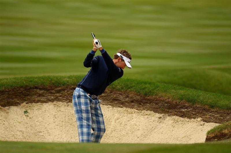 VIRGINIA WATER, ENGLAND - MAY 27:  Ian Poulter of England hits from a bunker on the 3rd hole during the second round of the BMW PGA Championship at the Wentworth Club on May 27, 2011 in Virginia Water, England.  (Photo by Richard Heathcote/Getty Images)