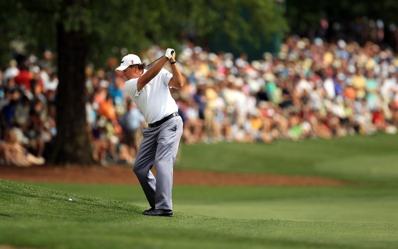 CHARLOTTE, NC - MAY 07:  Phil Mickelson hits a shot on the 7th hole during the third round of the Wells Fargo Championship at Quail Hollow Club on May 7, 2011 in Charlotte, North Carolina.  (Photo by Streeter Lecka/Getty Images)