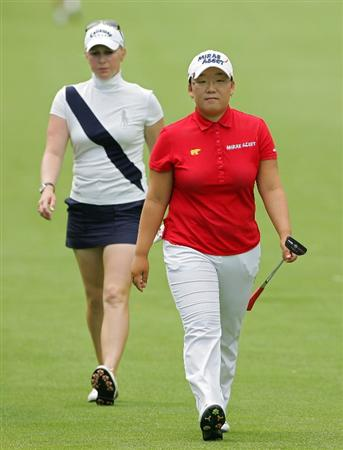 PITTSFORD, NY - JUNE 28:  Morgan Pressel of the USA (L) and Jiyai Shin of South Korea walk the fourth fairway during the final round of the Wegmans LPGA at Locust Hill Country Club held on June 28, 2009 in Pittsford, New York.  (Photo by Michael Cohen/Getty Images)