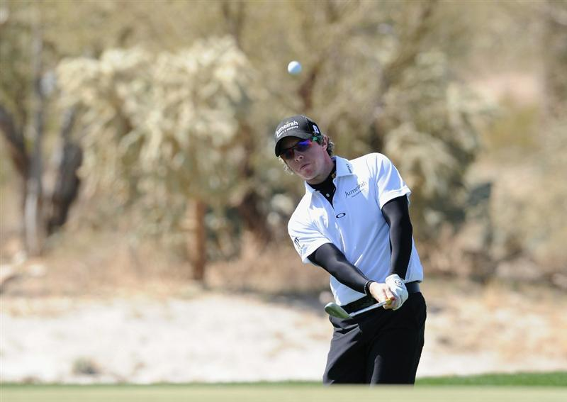 MARANA, AZ - FEBRUARY 23: Rory McIlroy of Northern Ireland plays his chip shot on the eighth hole during the first round of the World Golf Championships-Accenture Match Play Championship held at The Ritz-Carlton Golf Club, Dove Mountain on February 23, 2011 in Marana, Arizona.  (Photo by Stuart Franklin/Getty Images)