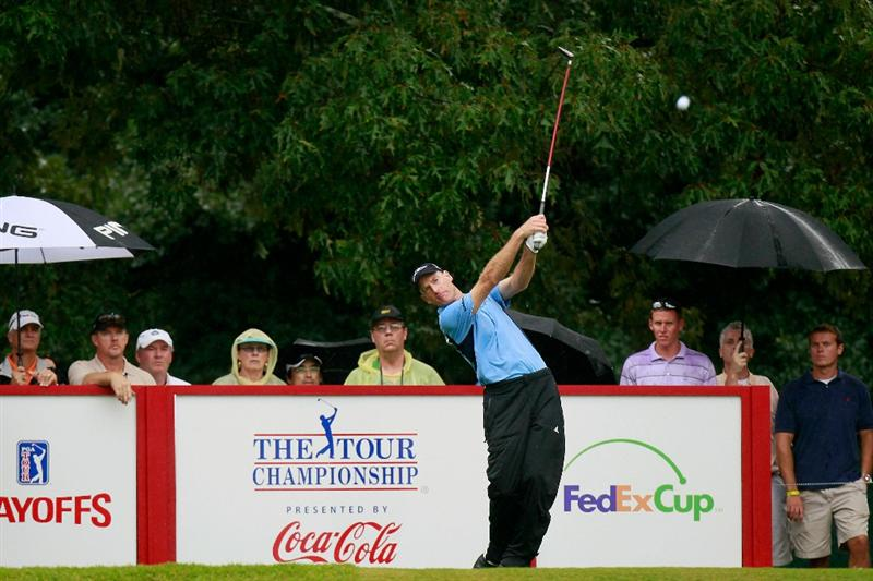 ATLANTA - SEPTEMBER 26:  Jim Furyk hits his tee shot on the 12th hole during the final round of THE TOUR Championship presented by Coca-Cola at East Lake Golf Club on September 26, 2010 in Atlanta, Georgia.  (Photo by Kevin C. Cox/Getty Images)