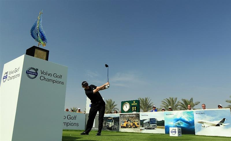 BAHRAIN, BAHRAIN - JANUARY 30:  Stephen Gallacher of Scotland plays his tee shot at the 1st hole during the final round of the 2011 Volvo Champions held at the Royal Golf Club on January 30, 2011 in Bahrain, Bahrain.  (Photo by David Cannon/Getty Images)