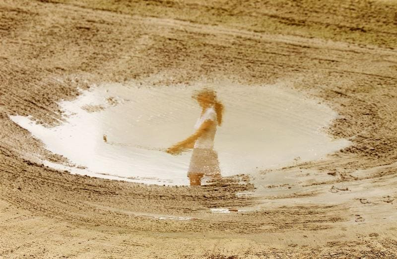 GOLD COAST, AUSTRALIA - MARCH 06:  Florentyna Parker of England is seen reflected in a flooded bunker as she chips onto the 2nd green during round three of the 2010 ANZ Ladies Masters at Royal Pines Resort on March 6, 2010 in Gold Coast, Australia.  (Photo by Ryan Pierse/Getty Images)