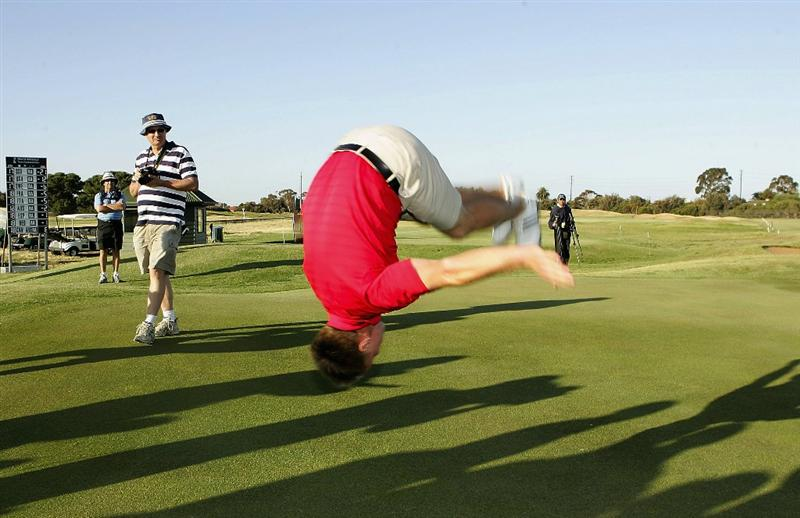 ADELAIDE, AUSTRALIA - OCTOBER 19:  Wallace Booth of Scotland does a backflip after winning the final day of the Eisenhower Trophy, which is part of the 2008 World Amateur Team Championship, held at Grange Golf Club October 19, 2008 in Adelaide, Australia.  (Photo by James Knowler/Getty Images)