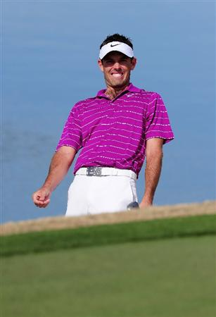 MARANA, AZ - FEBRUARY 19:  Charl Schwartzel of South Africa reacts to his bunker shot on the third hole during round three of the Accenture Match Play Championship at the Ritz-Carlton Golf Club on February 19, 2010 in Marana, Arizona.  (Photo by Stuart Franklin/Getty Images)