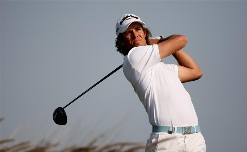 DOHA, QATAR - JANUARY 22:  Aaron Baddeley of Australia tees off on the 16th hole during the first round of  the Commercialbank Qatar Masters at Doha Golf Club on January 22, 2009 in Doha, Qatar.  (Photo by Andrew Redington/Getty Images)