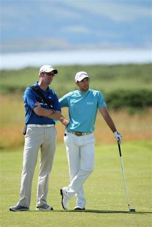 TURNBERRY, SCOTLAND - JULY 15:  Coach Hugh Marr chats to Oliver Wilson of England during a practice round prior to the 138th Open Championship on the Ailsa Course, Turnberry Golf Club on July 15, 2009 in Turnberry, Scotland.  (Photo by Andrew Redington/Getty Images)