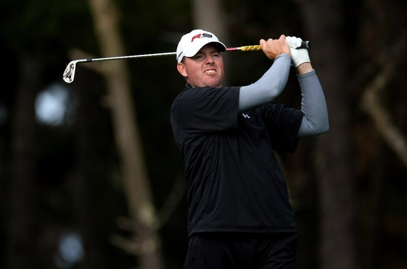 PEBBLE BEACH, CA - FEBRUARY 13:  Robert Garrigus hits his tee shot on the 11th hole during the second round of the AT&T Pebble Beach National Pro-Am at Poppy Hills Golf Course on February 13, 2009 in Pebble Beach, California.  (Photo by Stephen Dunn/Getty Images)