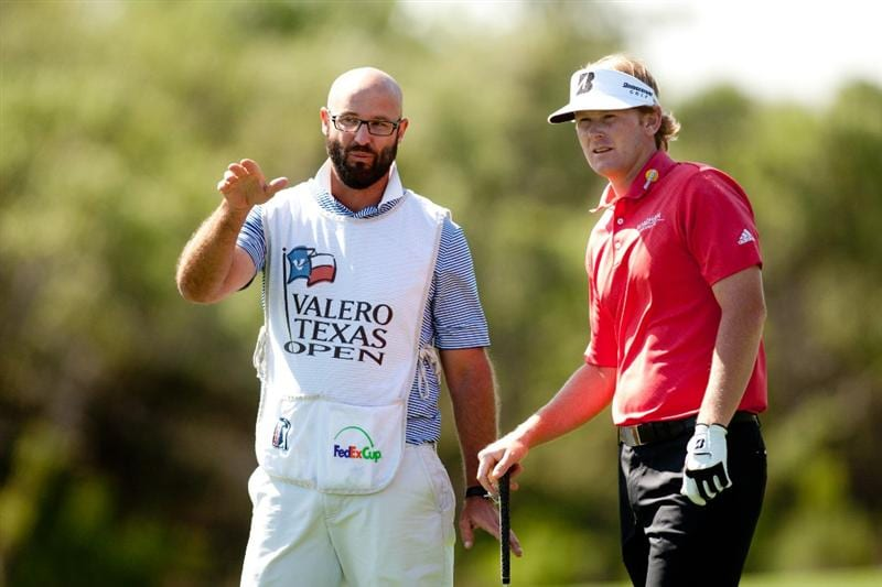 SAN ANTONIO, TX - APRIL 15: Brandt Snedeker and his caddie discuss a shot during the second round of the Valero Texas Open at the AT&T Oaks Course at TPC San Antonio on April 15, 2011 in San Antonio, Texas. (Photo by Darren Carroll/Getty Images)