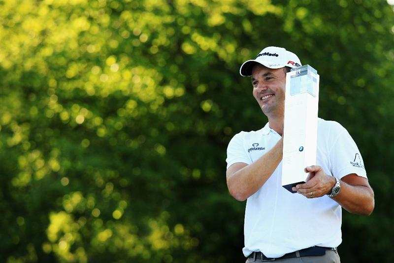 VIRGINIA WATER, ENGLAND - MAY 23:  Simon Khan of England celebrates with the trophy following his victory in the BMW PGA Championship on the West Course at Wentworth on May 23, 2010 in Virginia Water, England.  (Photo by Warren Little/Getty Images)