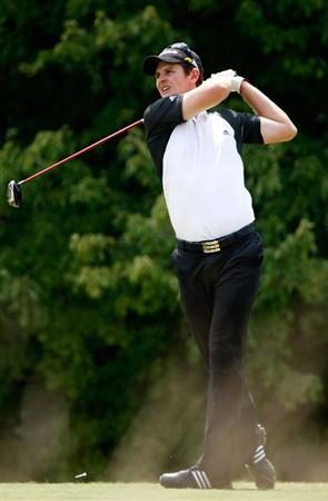 GREENSBORO, NC - AUGUST 23:  Justin Rose of England watches his tee shot on the 5th hole during the final round of the Wyndham Championship at Sedgefield Country Club on August 23, 2009 in Greensboro, North Carolina  (Photo by Streeter Lecka/Getty Images)