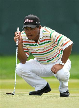 PARKER, CO. - MAY 28: Chien Soon Lu lines up a par putt on the par four 18th hole during the second round of the Senior PGA Championship at the Colorado Golf Club on May 28, 2010 in Parker, Colorado.  (Photo by Marc Feldman/Getty Images)