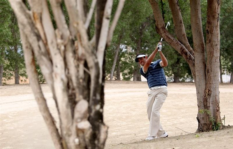 DUBAI, UNITED ARAB EMIRATES - FEBRUARY 06:  Charl Schwartzel of South Africa during the third round of the Omega Dubai Desert Classic on the Majlis Course at the Emirates Golf Club on February 6, 2010 in Dubai, United Arab Emirates.  (Photo by Ross Kinnaird/Getty Images)