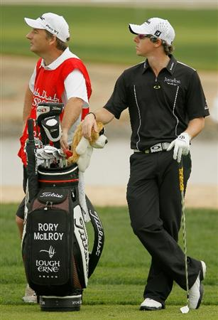ABU DHABI, UNITED ARAB EMIRATES - JANUARY 20:  Rory McIlroy of Northern Ireland waits with his caddie J.P. Fitzgerald on the ninth hole during the first round of the 2011 Abu Dhabi HSBC Golf Championship at the Abu Dhabi Golf Club on January 20, 2011 in Abu Dhabi, United Arab Emirates.  (Photo by Scott Halleran/Getty Images)