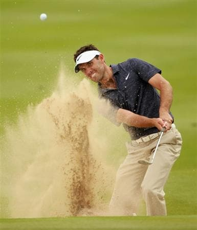 ABU DHABI, UNITED ARAB EMIRATES - JANUARY 20:  Charl Schwartzel of South Africa plays a bunker shot on the eighth hole during the first round of The Abu Dhabi HSBC Golf Championship at Abu Dhabi Golf Club on January 20, 2011 in Abu Dhabi, United Arab Emirates.  (Photo by Andrew Redington/Getty Images)