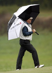 Tom Jenkins protects himself from the rain as he walks up the fourth fairway during the second round of the SAS Championship Saturday, October 7, 2006, at Prestonwood Country Club in Cary, North Carolina. Champions Tour - 2006 SAS Championship - Second RoundPhoto by Kevin C.  Cox/WireImage.com