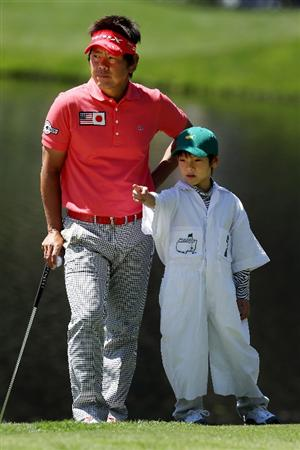 AUGUSTA, GA - APRIL 06:  Hiroyuki Fujita of Japan looks on next to his caddie during the Par 3 Contest prior to the 2011 Masters Tournament at Augusta National Golf Club on April 6, 2011 in Augusta, Georgia.  (Photo by Andrew Redington/Getty Images)