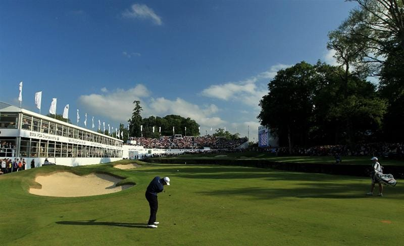 VIRGINIA WATER, ENGLAND - MAY 29:  (EDITORS NOTE: A POLARIZING FILTER WAS USED IN THE CAPTURE OF THIS IMAGE) Lee Westwood of England hits his approach shot to the 18th green in a playoff during the final round of the BMW PGA Championship  at the Wentworth Club on May 29, 2011 in Virginia Water, England.  (Photo by David Cannon/Getty Images)