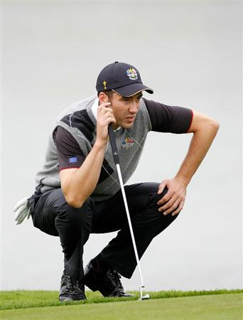 NEWPORT, WALES - SEPTEMBER 28:  Ross Fisher of Europe lines up a putt during a practice round prior to the 2010 Ryder Cup at the Celtic Manor Resort on September 28, 2010 in Newport, Wales. (Photo by Sam Greenwood/Getty Images)